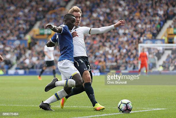 Idrissa Gueye of Everton battle for possession with Christian Eriksen of Tottenham Hotspur during the Premier League match between Everton and...