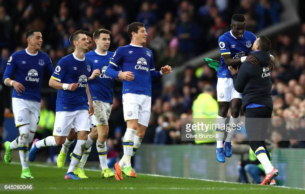Idrissa Gueye of Everton celebrates scoring his sides first goal with his Everton team mates during the Premier League match between Everton and...
