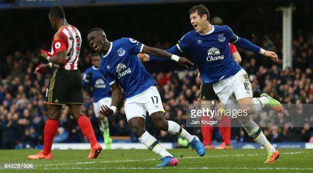 Idrissa Gueye of Everton celebrates scoring his sides first goal with Ross Barkley of Everton during the Premier League match between Everton and...