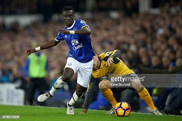 Idrissa Gueye of Everton goes past Granit Xhaka of Arsenal during the Premier League match between Everton and Arsenal at Goodison Park on December...