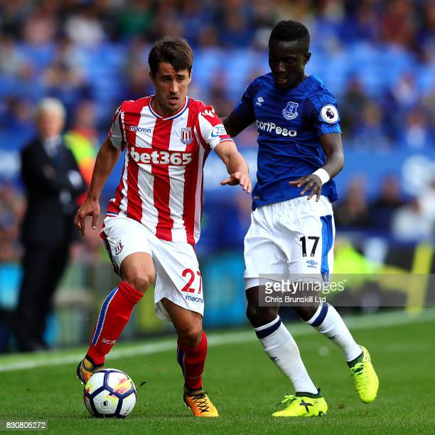 Idrissa Gueye of Everton in action with Bojan Krkic of Stoke City during the Premier League match between Everton and Stoke City at Goodison Park on...