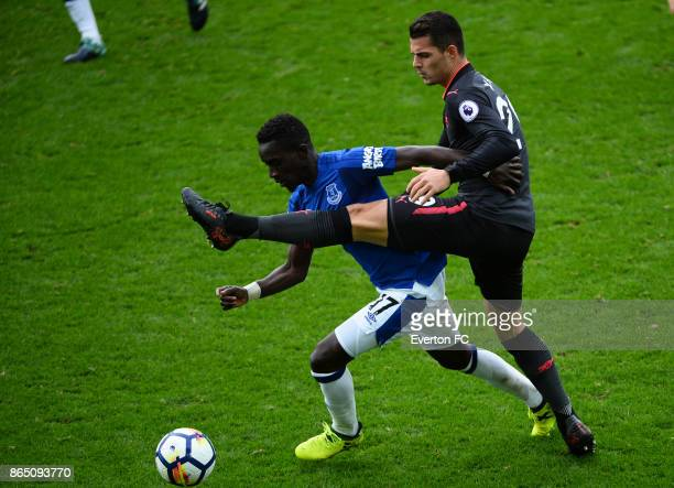 Idrissa Gueye of Everton is battles with Granit Xhaka of Arsenal during the Premier League match between Everton and Arsenal at Goodison Park on...