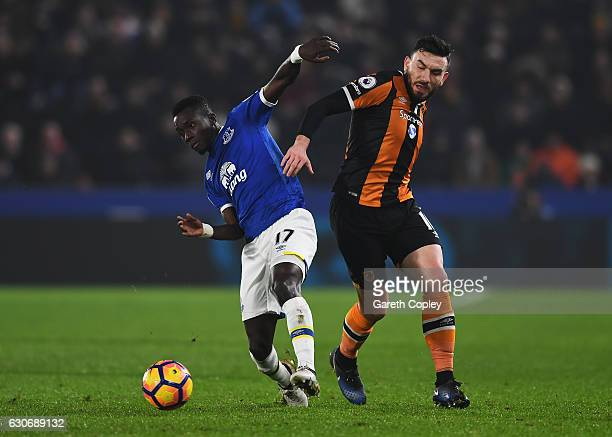 Idrissa Gueye of Everton is challenged by Robert Snodgrass of Hull City during the Premier League match between Hull City and Everton at KCOM Stadium...