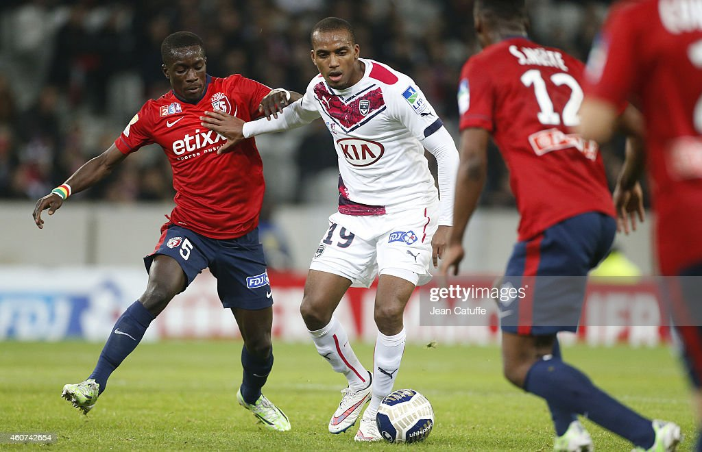 Idrissa Gueye of Lille and <a gi-track='captionPersonalityLinkClicked' href=/galleries/search?phrase=Nicolas+Maurice-Belay&family=editorial&specificpeople=2082243 ng-click='$event.stopPropagation()'>Nicolas Maurice-Belay</a> of Bordeaux in action during the French League Cup (Coupe de la ligue) match between Lille OSC and Girondins de Bordeaux at Grand Stade Pierre Mauroy stadium on December 17, 2014 in Lille, France.
