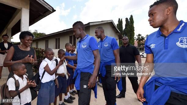 Idrissa Gueye Yannick Bolasie and Ademola Lookman of Everton visit Uhuru Primary School in DarEsSalaam on July 12 2017 in Dar es SalaamTanzania