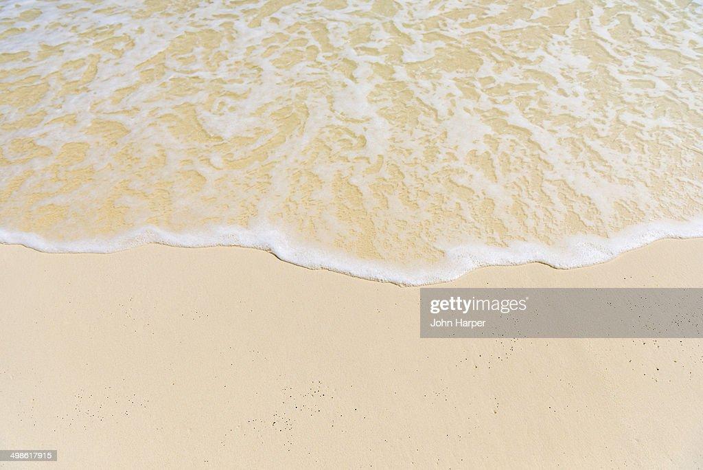 Idyllic beach wave in the Maldives
