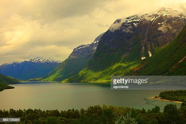 Idyllic fjord landscape reflection, dramatic sunset, Norway, Nordic Countries