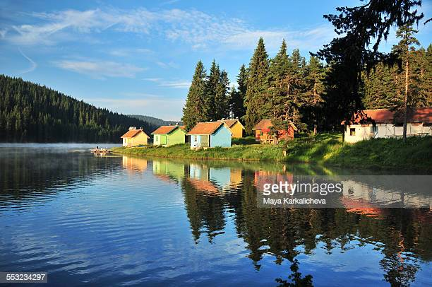 Idyllic log cabins by a mountain lake