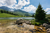 An idyllic mountain lake landscape in the Swiss Alps
