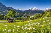 Beautiful mountain landscape in the Bavarian Alps with village of Berchtesgaden and Watzmann massif in the background at sunrise, Nationalpark Berchtesgadener Land, Bavaria, Germany.