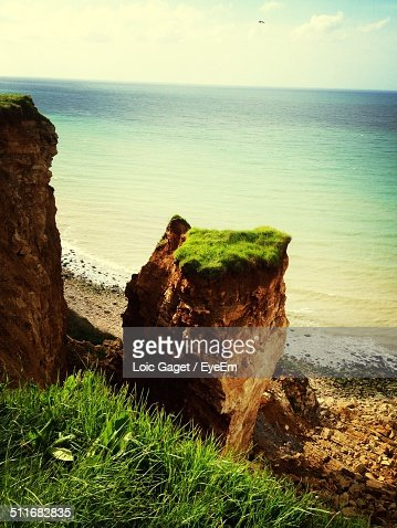 Idyllic nature scenery with rock cliffs and sea