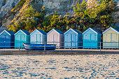 Idyllic seaside beach huts in England