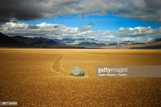 Idyllic Shot Of Sailing Stone On Desert Landscape At Death Valley National Park