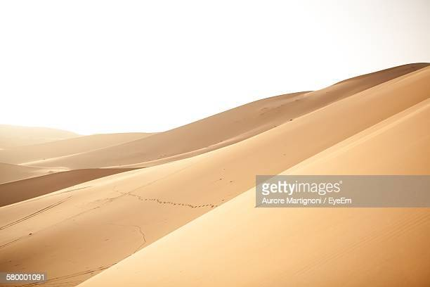 Idyllic Shot Of Sand Dunes Against Clear Sky