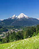 Panoramic view of beautiful landscape in the Bavarian Alps with famous Watzmann mountain in the background in springtime, Nationalpark Berchtesgadener Land, Bavaria, Germany