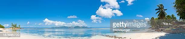 Idyllic tropical island paradise beach house boats ocean lagoon panorama
