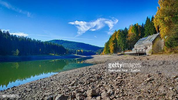 Idyllic View Of Calm Lake Against Sky During Autumn