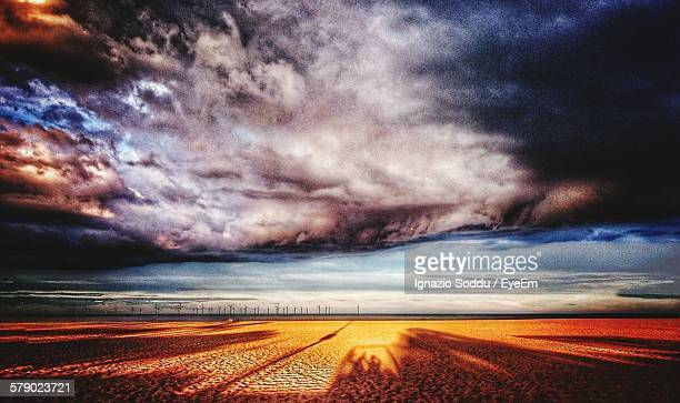 Idyllic View Of Dramatic Sky Over Filed
