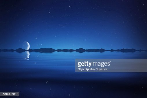 Idyllic View Of Lake Against Blue Sky At Night
