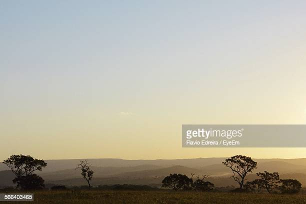 Idyllic View Of Landscape Against Sky During Sunset