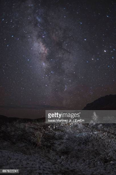 Idyllic View Of Milky Way And Stars In Sky Over Field At Night