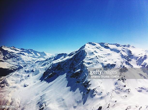 Idyllic View Of Snowcapped Mountain Against Blue Sky In Bormio