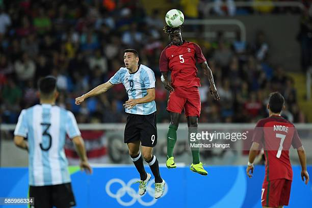 Ie Edgar of Portugal heads the ball over Jonathan Calleri of Argentina as Andre Martins of Portugal and Alexis Soto of Argentina look on during the...