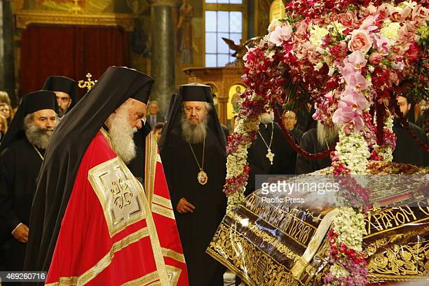 Ieronymos II the Archbishop of Athens and All Greece and primate of the Orthodox Church of Greece stands in front of the epitaph in the Agios...