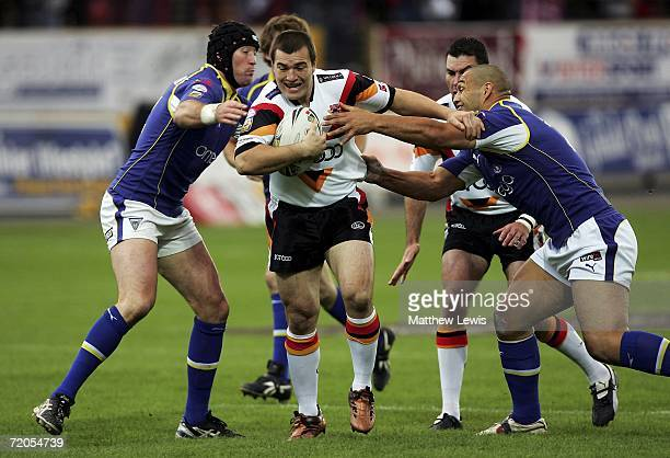 Iestyn Harris of Bradford breaks through the defence of Mike Wainwright and Paul Rauhihi of Warrington during the Engage Super League match between...