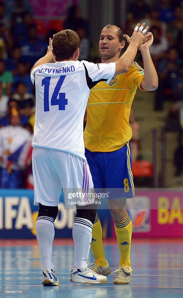 Ievgen Rogachov of Ukraine celebrates with goalkeeper Dmytro Lytvynenko during the FIFA Futsal World Cup Group A match between Thailand and Ukraine at Indoor Stadium Huamark on November 4, 2012 in Bangkok, Thailand.