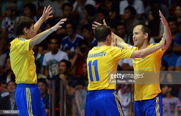 Ievgen Rogachov of Ukraine celebrates with team mates after scoring a goal during the FIFA Futsal World Cup Round of 16 match between Ukraine and...