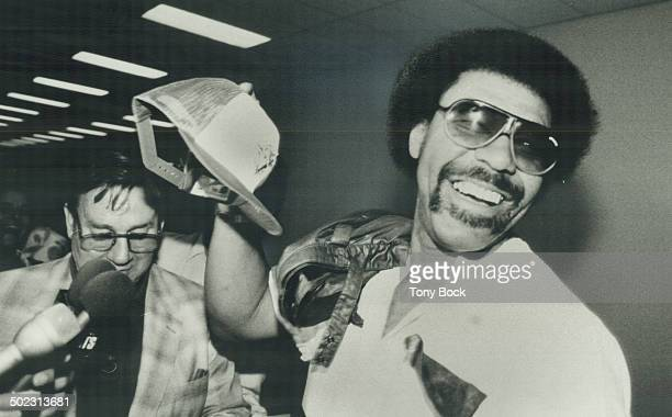 If the cap fits Cliff Johnson has rejoined the Blue Jays and you can see how delighted he is as he arrives at Pearson International It feels good...