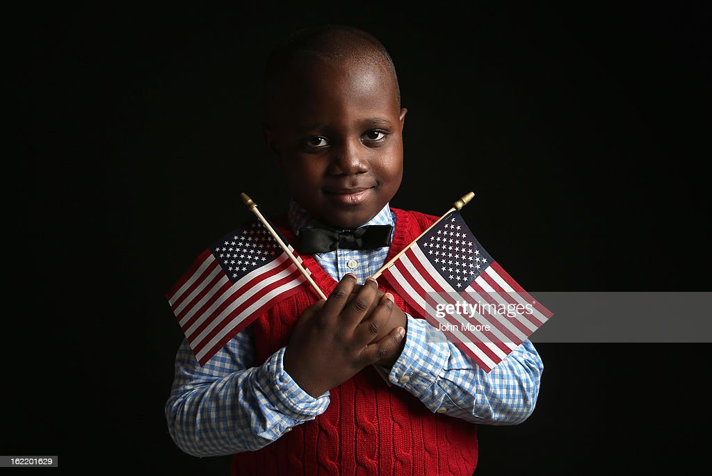 Ifeozuwa Oyaniyi, 5, born in Nigeria, holds flags given to him by the U.S. Citizenship and Immigration Services (USCIS), while waiting to receive his citizenship certificate on February 19, 2013 in New York City. His father, Oluwaseyi Oyaniyi, is a housing inspector, and their family lives in the Bronx, New York City. Almost 300 foreign-born children of naturalized Americans received citizenship certificates Tuesday at the USCIS center during the special event. Children of naturalized immigrants receive U.S. citizenship if they arrive to the United States as minors, but they must go through a process at USCIS to receive official citizenship documents proving they have become Americans.