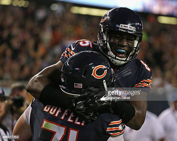 Ify Umodu of the Chicago Bears celebrates his touchdown catch with teammates Conor Boffeli against the Cleveland Browns during a preseason game at...