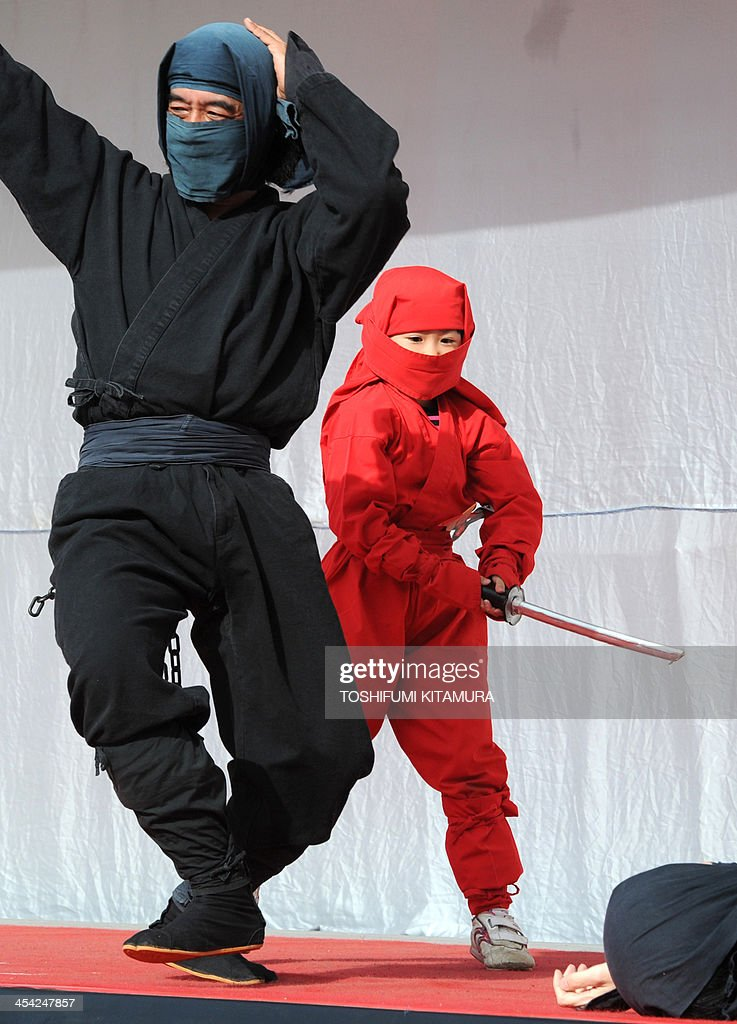 Iga city's ninja team, 'Kurondo' perform during the Iga-Ueno Ninja Festival at the Ueno park in Iga city on December 8, 2013. Iga city in Mie prefecture, about 350-kilometre west of Tokyo, a birthplace of Iga-style ninjas, held the two-day-long festival to attract visitors to the city.