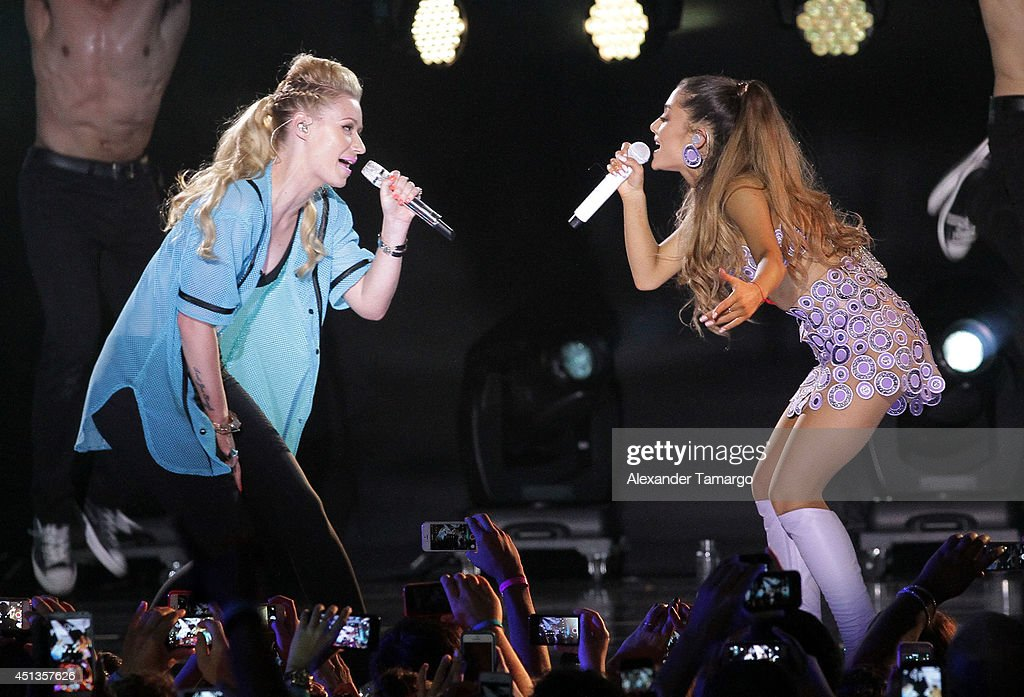 Iggy Azalea and Ariana Grande perform onstage at iHeartRadio Ultimate Pool Party Presented By VISIT FLORIDA At Fontainebleau's BleauLive at Fontainebleau Miami Beach on June 27, 2014 in Miami Beach, Florida.
