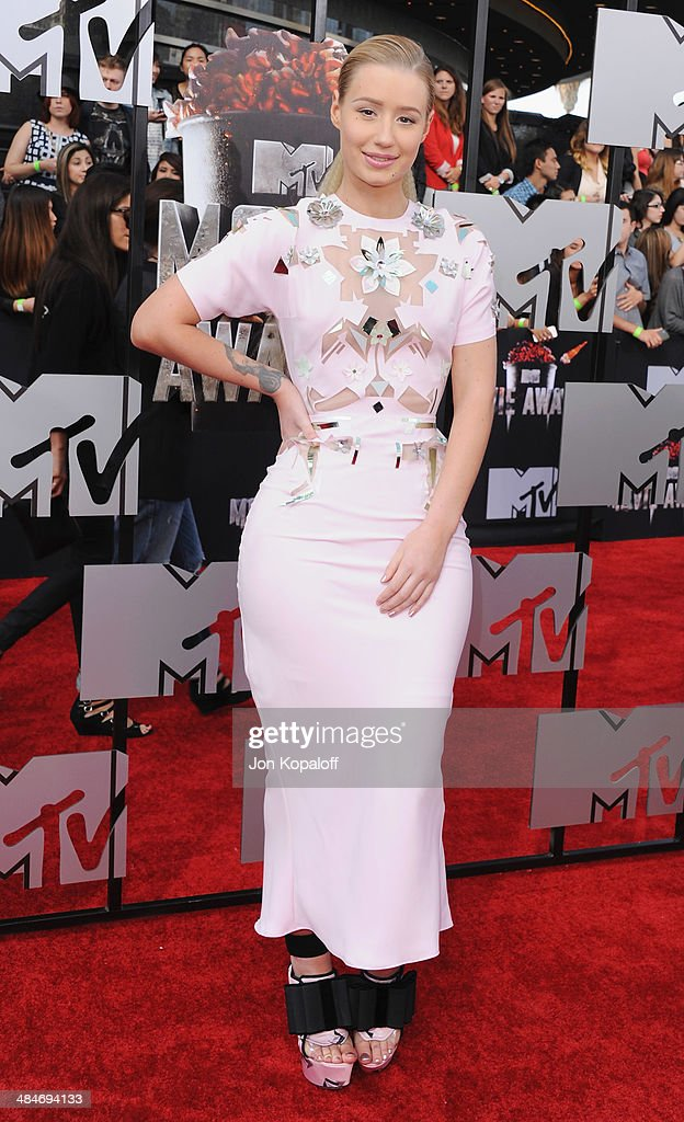 Iggy Azalea arrives at the 2014 MTV Movie Awards at Nokia Theatre L.A. Live on April 13, 2014 in Los Angeles, California.