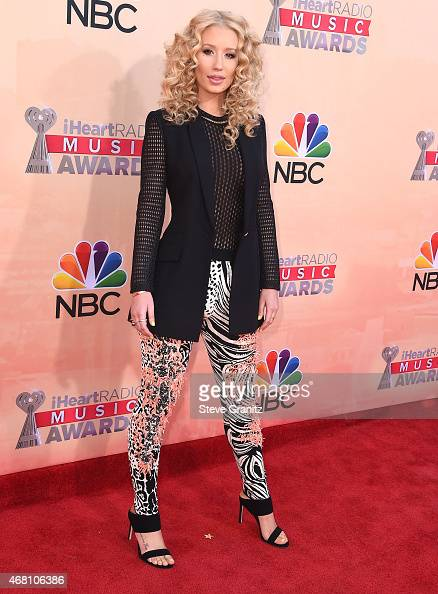 Iggy Azalea arrives at the 2015 iHeartRadio Music Awards at The Shrine Auditorium on March 29 2015 in Los Angeles California
