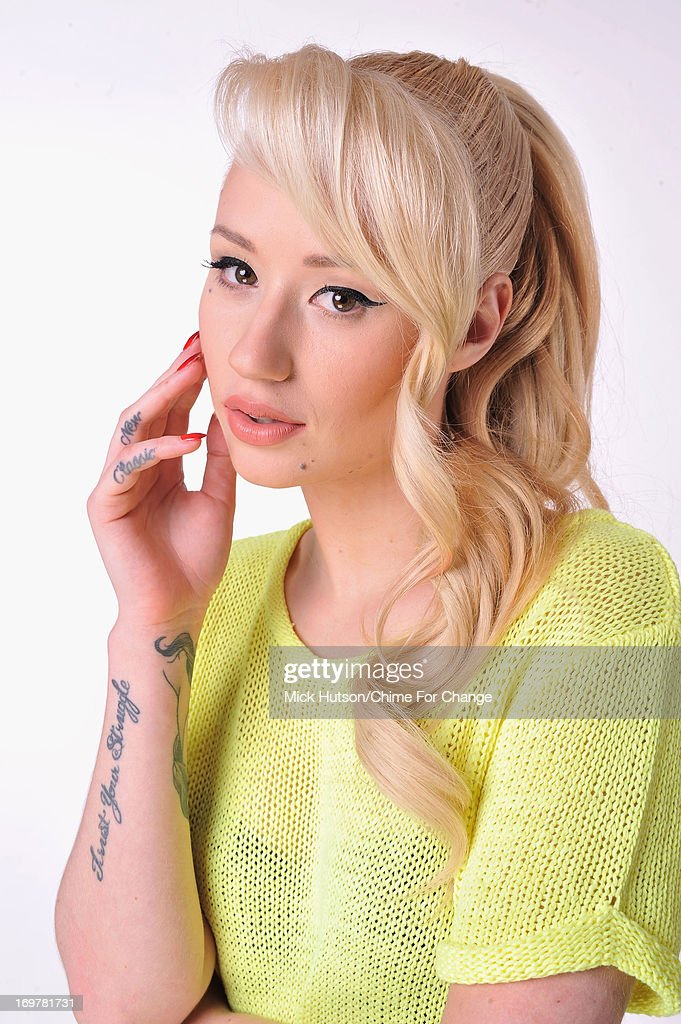 <a gi-track='captionPersonalityLinkClicked' href=/galleries/search?phrase=Iggy+Azalea&family=editorial&specificpeople=8558263 ng-click='$event.stopPropagation()'>Iggy Azalea</a> poses for a portrait backstage at the 'Chime For Change: The Sound Of Change Live' Concert at Twickenham Stadium on June 1, 2013 in London, England. Chime For Change is a global campaign for girls' and women's empowerment founded by Gucci with a founding committee comprised of Gucci Creative Director Frida Giannini, Salma Hayek Pinault and Beyonce Knowles-Carter.