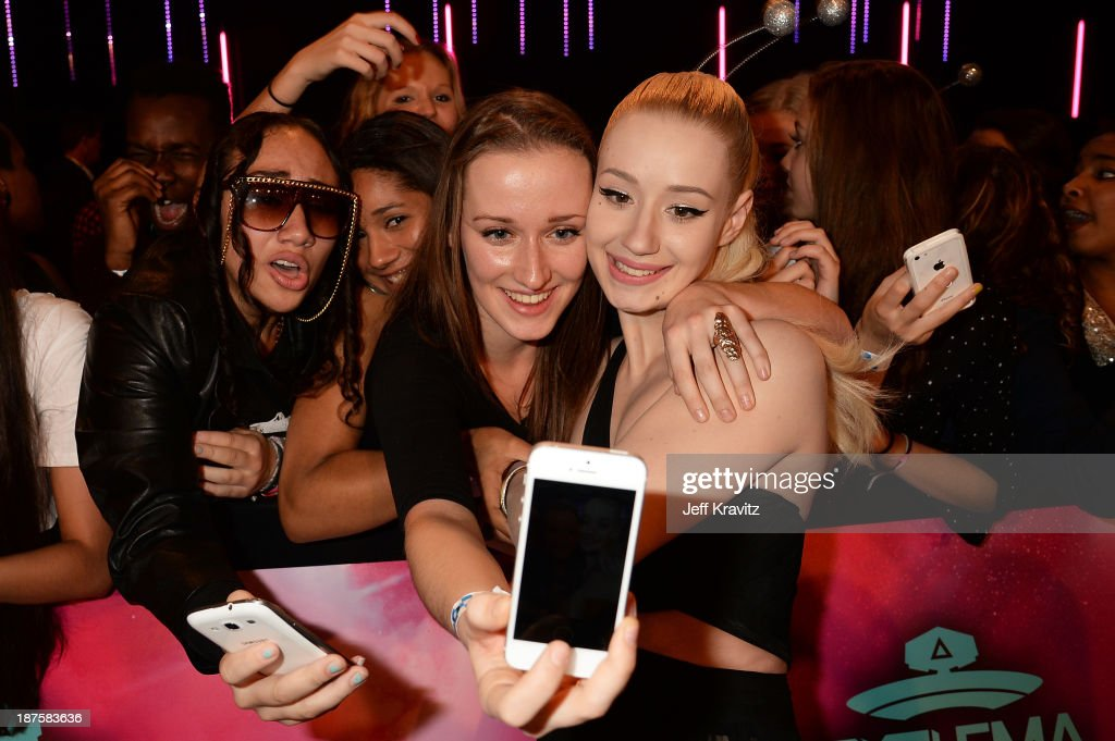 <a gi-track='captionPersonalityLinkClicked' href=/galleries/search?phrase=Iggy+Azalea&family=editorial&specificpeople=8558263 ng-click='$event.stopPropagation()'>Iggy Azalea</a> poses with a fan for a picture as she attends the MTV EMA's 2013 at the Ziggo Dome on November 10, 2013 in Amsterdam, Netherlands.