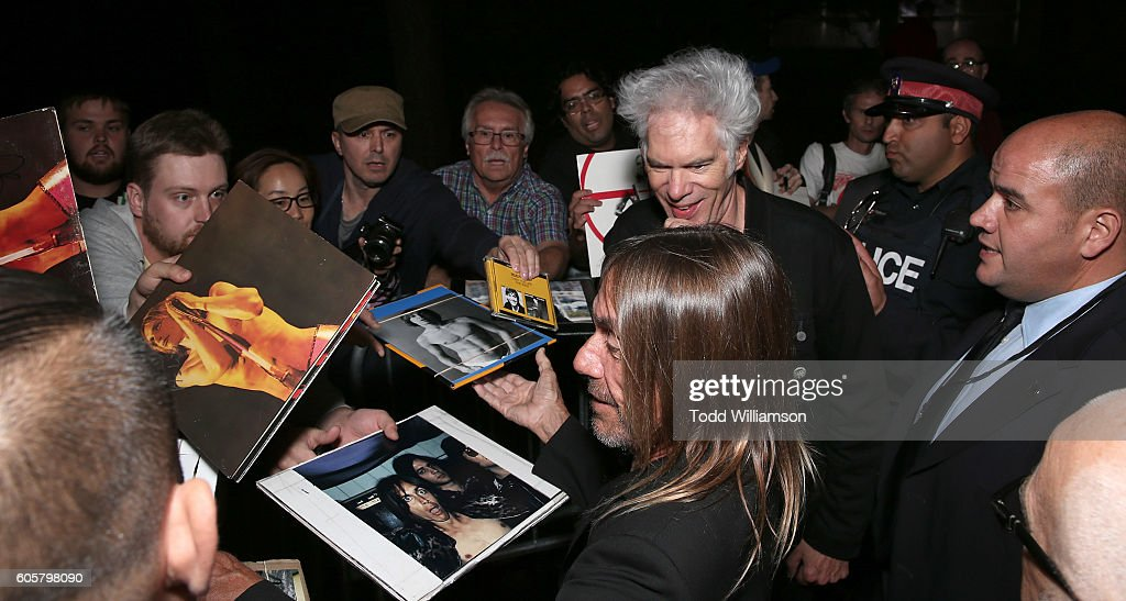 Iggy Pop and Jim Jarmusch sign autographs at the Premiere of Amazon Studios' 'Gimme Danger' at the Toronto International Film Festival at Ryerson Theatre on September 14, 2016 in Toronto, Canada.