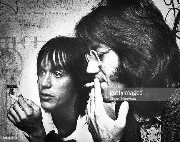 Iggy Pop and Ray Manzarek from The Doors smoke cigarettes backstage at the Whisky a Go Go club in Los Angeles California in 1974