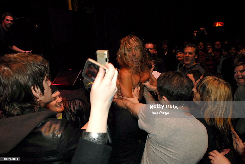 Iggy Pop (center) and The Stooges during Iggy Pop and The Stooges Perform at United Palace Theatre in New York City at United Palace Theatre in New York City, New York, United States.