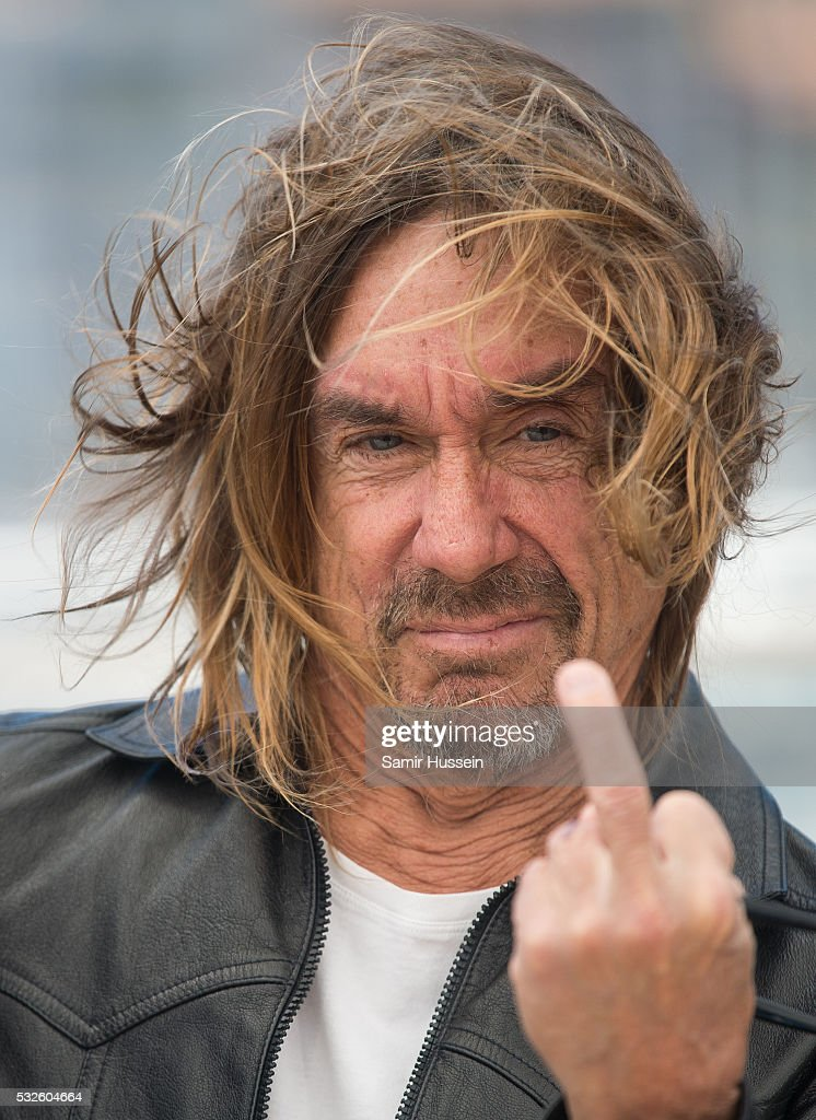 <a gi-track='captionPersonalityLinkClicked' href=/galleries/search?phrase=Iggy+Pop&family=editorial&specificpeople=171445 ng-click='$event.stopPropagation()'>Iggy Pop</a> gestures as he attends the 'Gimme Danger' Photocall at the annual 69th Cannes Film Festival at Palais des Festivals on May 19, 2016 in Cannes, France.
