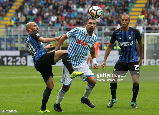 Iglesias Borja Valero of FC Internazionale competes for the ball with Marco Borriello of Spal during the Serie A match between FC Internazionale and...
