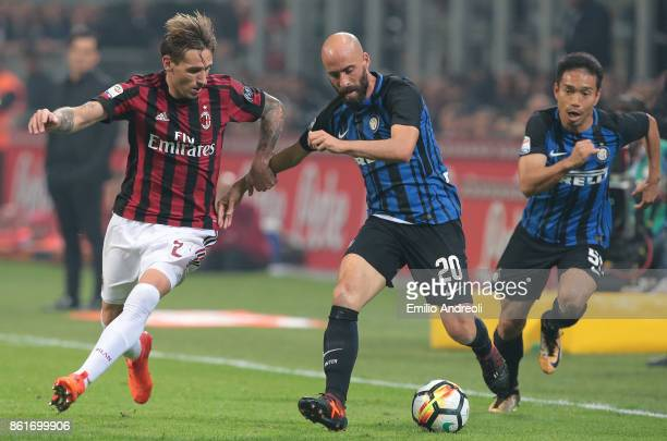 Iglesias Borja Valero of FC Internazionale Milano competes for the ball with Lucas Biglia of AC Milan during the Serie A match between FC...