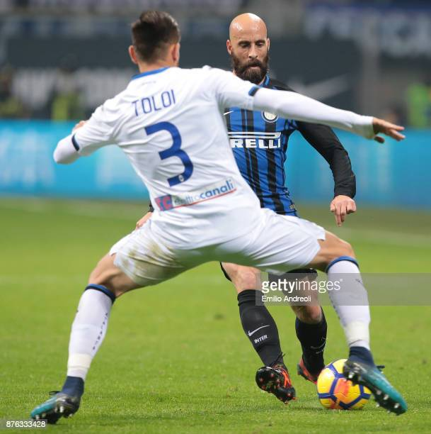 Iglesias Borja Valero of FC Internazionale Milano is challenged by Rafael Toloi of Atalanta BC during the Serie A match between FC Internazionale and...