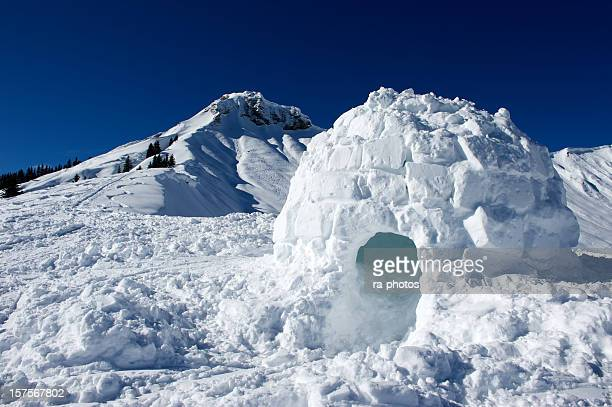 Igloo made of snow near mountain
