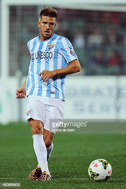 ADELAIDE AUSTRALIA JULY Ignacio Camacho Barnola of Malaga runs with the ball during the international club friendly match between Adelaide United and...