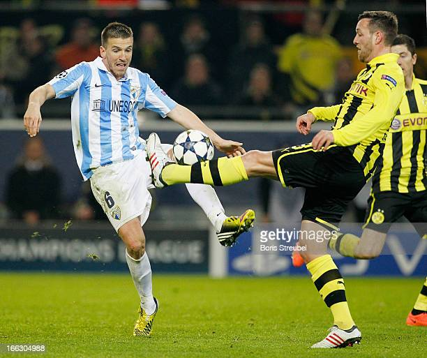 Ignacio Camacho of Malaga battles for the ball with Julian Schieber of Borussia Dortmund during the UEFA Champions League quarterfinal second leg...